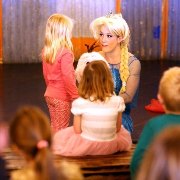 Frozen Elsa with child & Olaf on stage