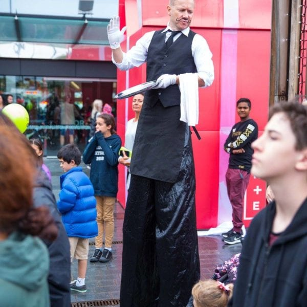 Stiltwalking waiter at NWM