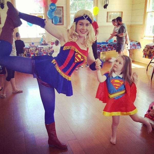 Supergirl poses with Supergirl fan