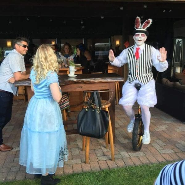White Rabbit unicycling with Alice