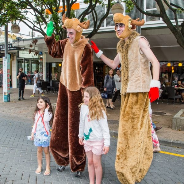 Stiltwalking reindeer duo with kids 2