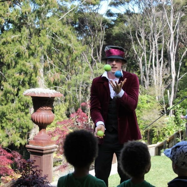 Mad Hatter juggling at 80th birthday garden party