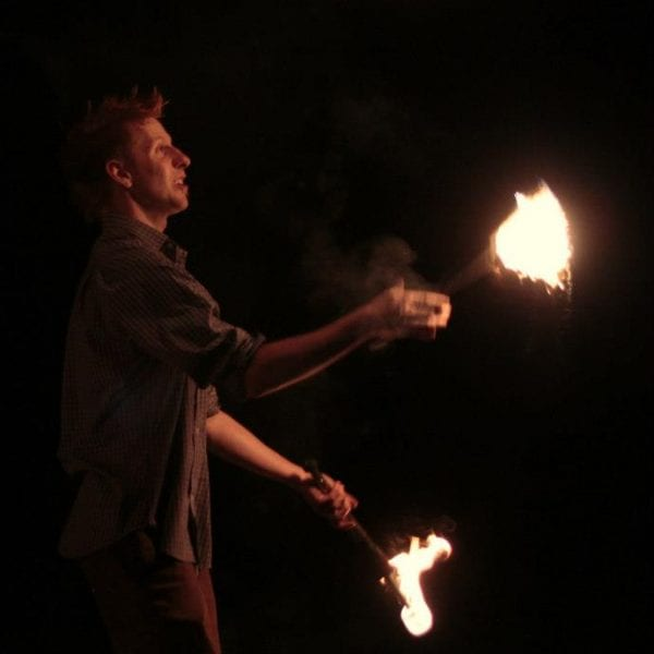 Fire performer juggling flames